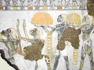Fig. 1: Tumba de Sobekhotep Africanos ofrendando anillos y pepitas de oro de Nubia.